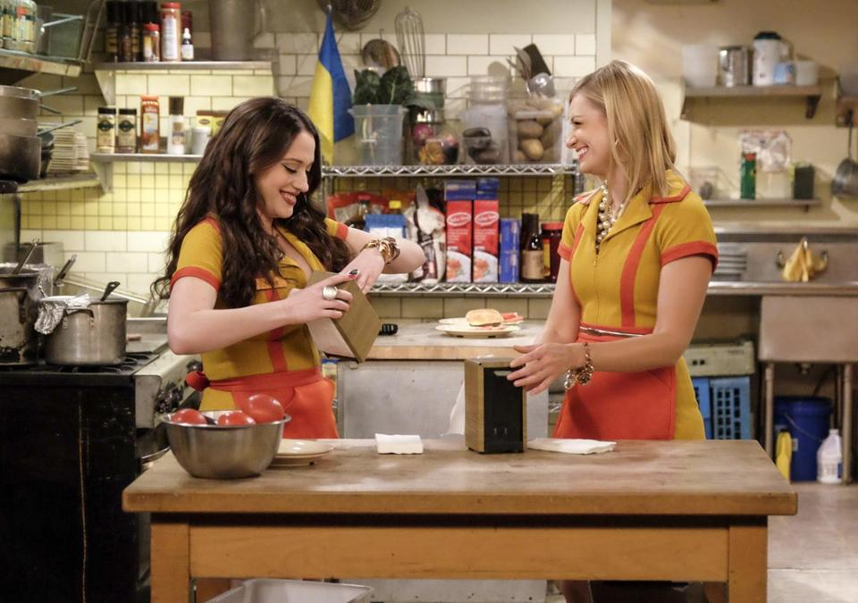 "Kat Dennings (left) and Beth Behrs in ""2 Broke Girls."""