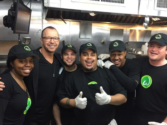 Donnie Wahlberg and the chefs at newly opened Wahlburgers on Manhattan's Upper East Side.