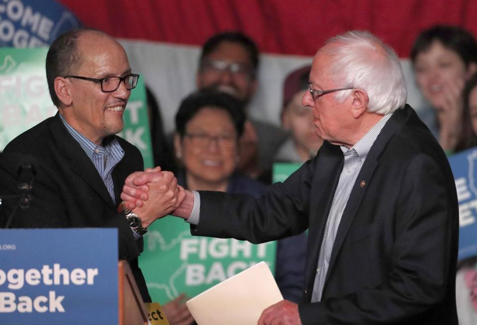 SALT LAKE CITY, UT - APRIL 21: Sen. Bernie Sanders (D-VT), (R), greets DNC Chairman Tom Perez, (L) on stage as he gets ready to speak to a crowd of supporters at a Democratic unity rally at the Rail Event Center on April 21, 2017 in Salt Lake City, Utah. Sanders and Perez are holding several rallies around the country trying unify the Democratic party. (Photo by George Frey/Getty Images)