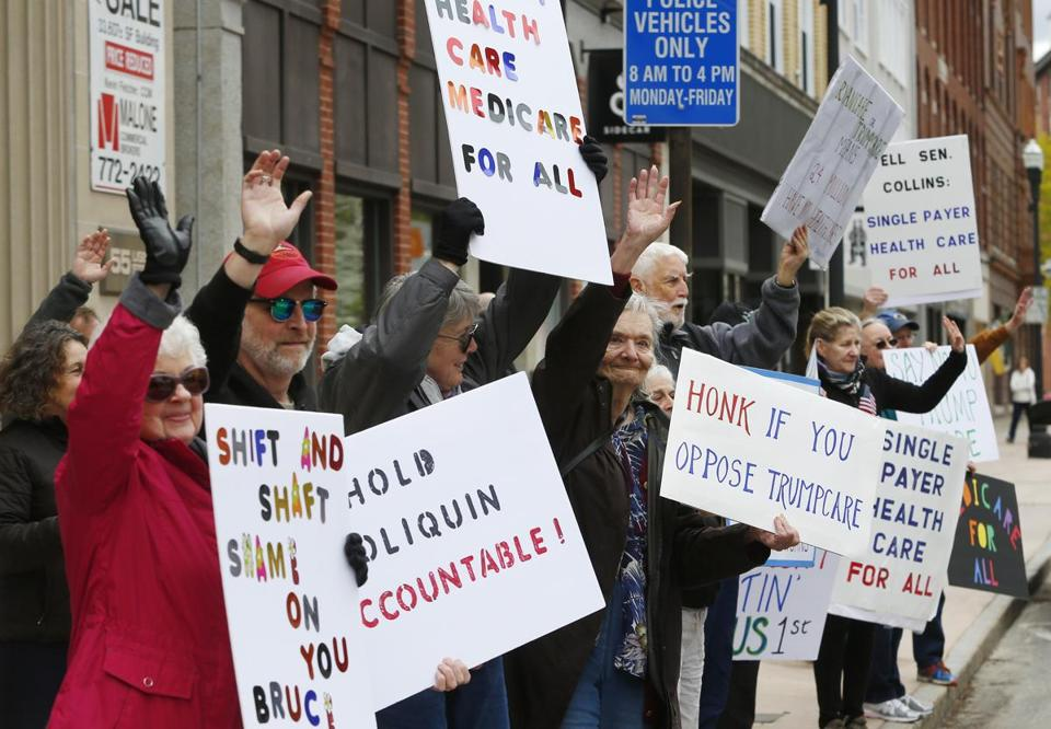 Protesters picketed outside of US Senator Susan Collins's office in Lewiston, Maine.