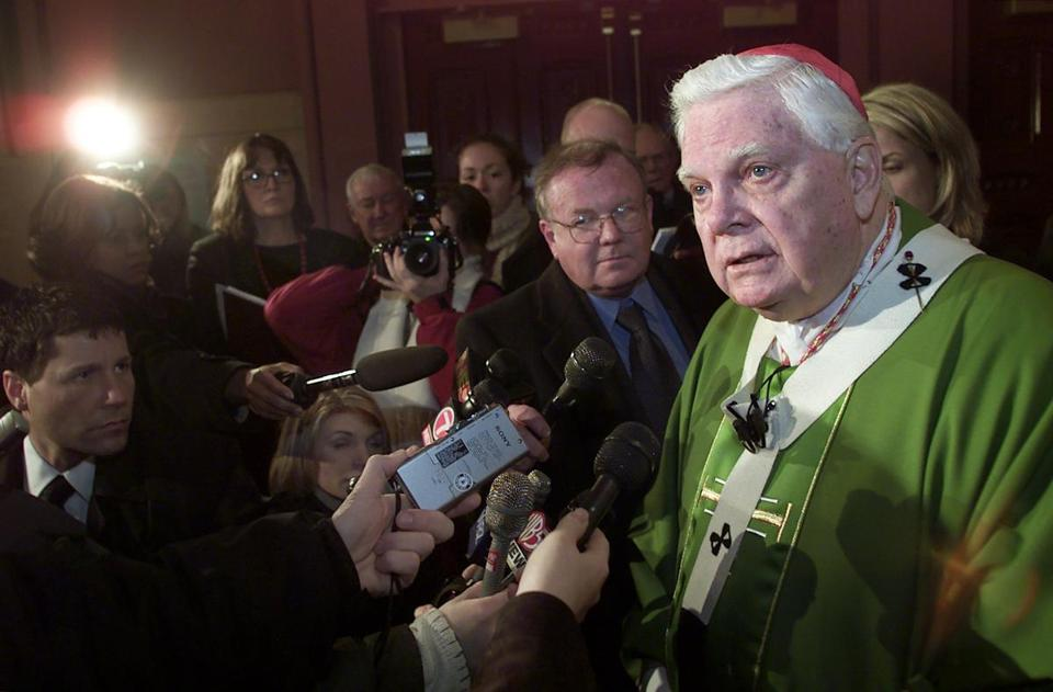 BOSTON:2/10/02- Cardinal Bernard Law speaks with media after Mass at the Cathedral of the Holy Cross. GLOBE STAFF PHOTO BY TOM HERDE -- Library Tag 02112002 Metro BOSTON GLOBE SPOTLIGHT SERIES: CHILD SEX ABUSE SCANDAL IN THE CATHOLIC CHURCH. catholicsexscandal