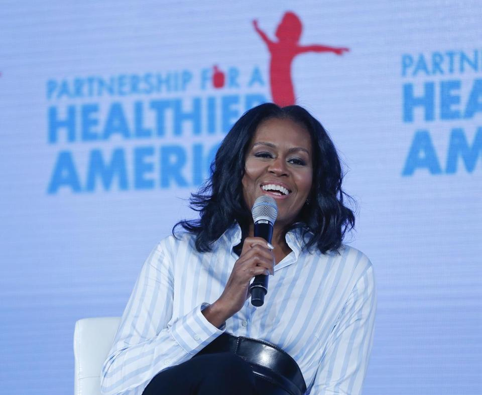 Former first lady Michelle Obama smiles while speaking at the Partnership for a Healthier American 2017 Healthier Future Summit in Washington, Friday, May 12, 2017. Obama appeared at an annual health conference sponsored by the nonprofit organization that sponsored her anti-childhood obesity initiative. (AP Photo/Pablo Martinez Monsivais)