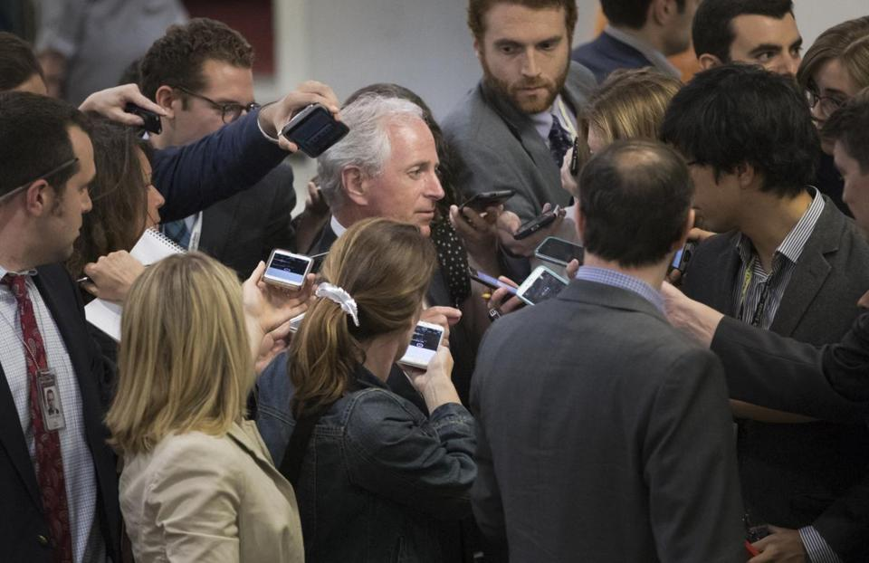 Senate Foreign Relations Committee Chairman Sen. Bob Corker, R-Tenn., is surrounded by reporters looking for a reaction on President Donald Trump's meeting with Russian officials, Tuesday, May 16, 2017, on Capitol Hill in Washington. (AP Photo/J. Scott Applewhite)