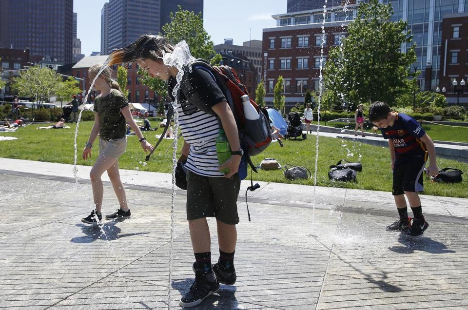 Students who were visiting Boston from Cape Elizabeth Middle School in Maine jumped into the fountain along the Rose Kennedy Greenway as temperatures went into the 90's in Boston.