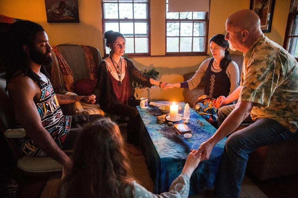 05/12/2017 WOLFEBORO, NH L-R Josue Joseph (cq), Rebecca Gronski (cq), Emily Marsh (cq) and Brooks Campbell (cq) meditate at Marsh's home in Wolfeboro, NH. (Aram Boghosian for The Boston Globe)