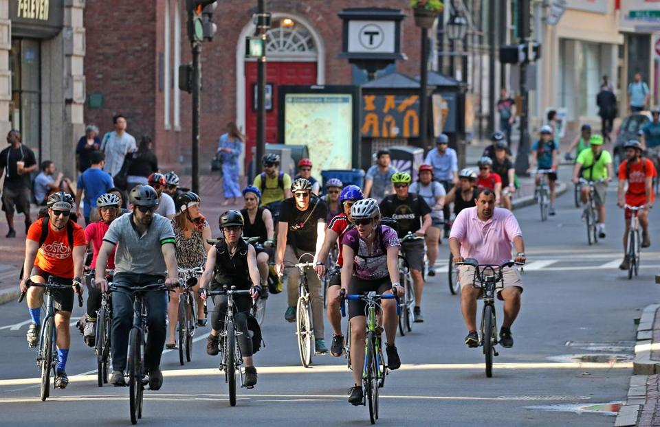 BOSTON, MA - 5/19/2017:Bikers in mass rdie down Washington Street Boston. National Bike to Work Day on Friday, May 19, 2017. In total, 13 bike convoys will made stops at locations across the metro Boston area, and cyclists will meet at Boston City Hall Plaza in the morning for a festival that will include music, exhibits and breakfast. Other cyclists gathered at City Hall Plaza, wearing black in protest and for a silent vigil. (David L Ryan/Globe Staff Photo) SECTION: METRO TOPIC 20jaywalkers