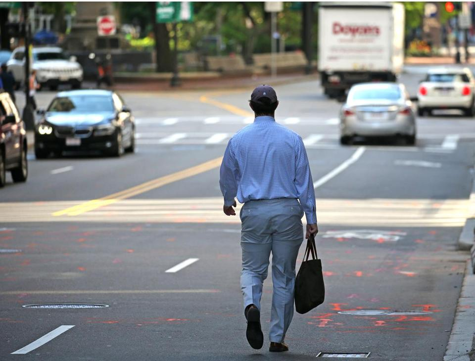 A pedestrian walked on Congress Street last week with his back toward traffic.