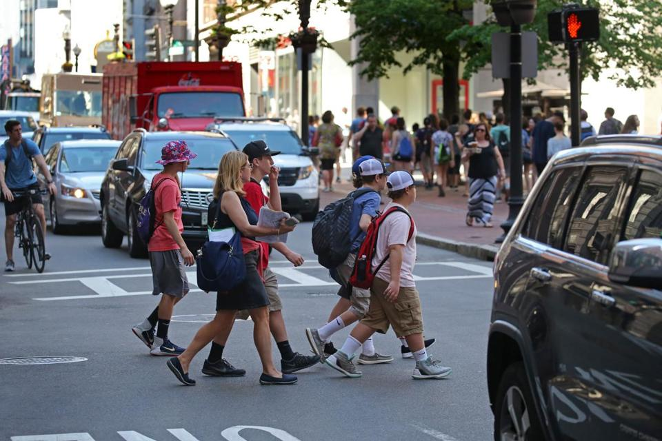 A group crossed Washington Street in Boston last week against traffic and outside the crosswalk.