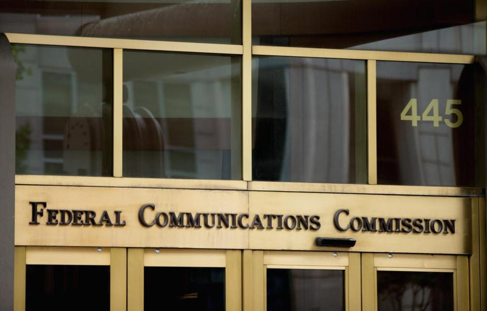 A veteran Washington reporter says he was manhandled by security guards from the Federal Communications Commission, then forced out of the agency's headquarters.