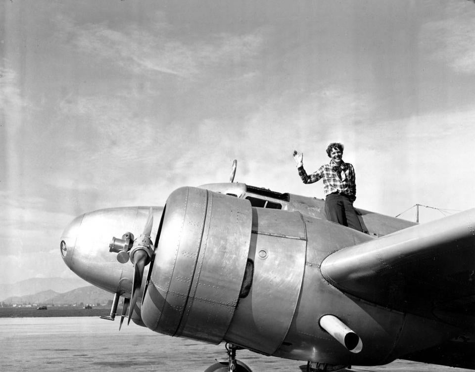 FILE - In a March 10, 1937 file photo American aviatrix Amelia Earhart waves from the Electra before taking off from Los Angeles, Ca., on March 10, 1937. Earhart is flying to Oakland, Ca., where she and her crew will begin their round-the-world flight to Howland Island on March 18. (AP Photo, file)