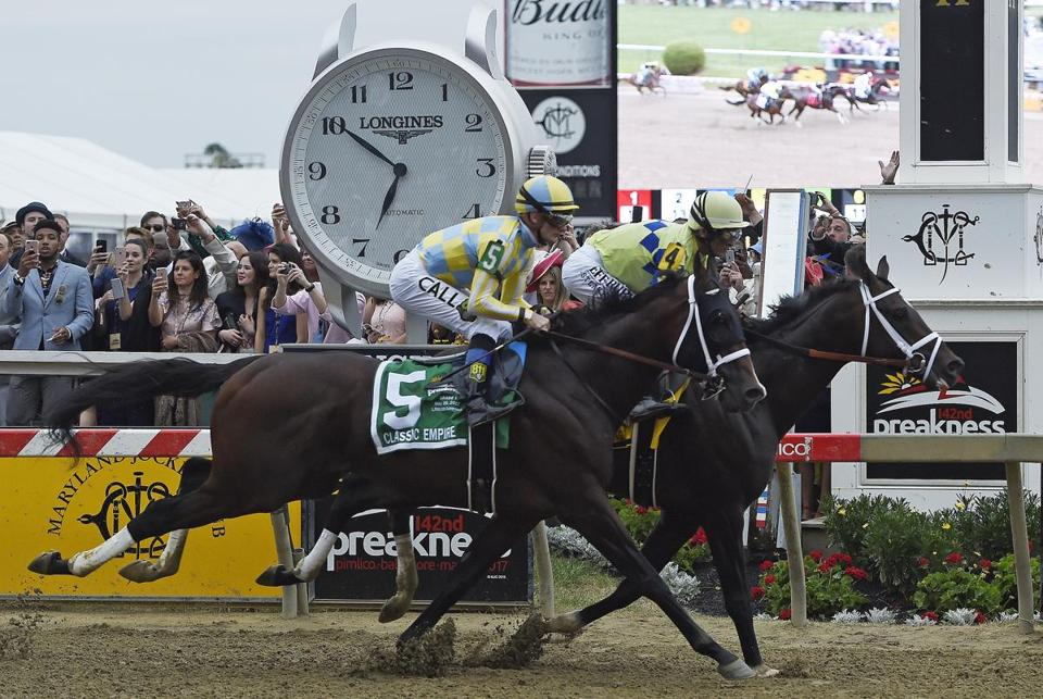Cloud Computing (2), ridden by Javier Castellano, wins142nd Preakness Stakes horse race at Pimlico race course as Classic Empire with Julien Leparoux aboard takes second, Saturday, May 20, 2017, in Baltimore. (AP Photo/Mike Stewart)