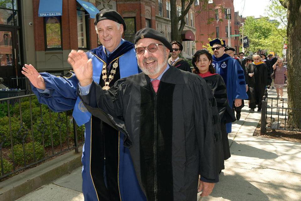 Bob Vila (front right) with BAC president Glen LeRoy leading the college's processional down Newbury Street to Old South Church.