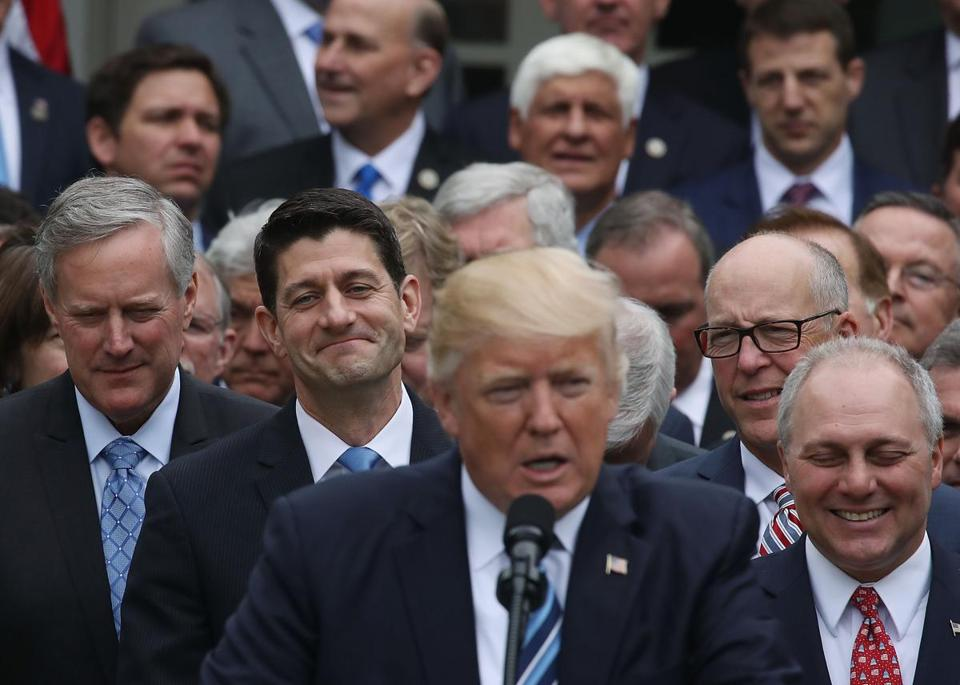 WASHINGTON, DC - MAY 04: House Speaker Paul Ryan (R-WI) (2nd-L) listens as U.S. President Donald Trump congratulates House Republicans after they passed legislation aimed at repealing and replacing ObamaCare, during an event in the Rose Garden at the White House, on May 4, 2017 in Washington, DC. The House bill would still need to be passed by the Senate before it could be signed into law. (Photo by Mark Wilson/Getty Images)