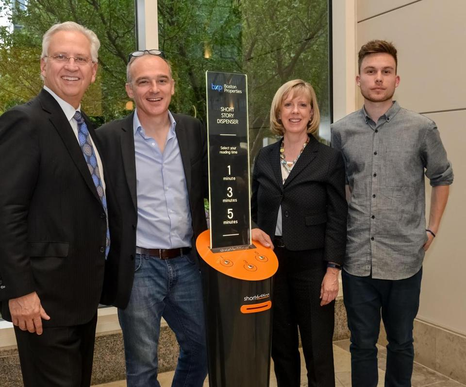 From left: Bryan Koop, executive vice president at Boston Properties, Christophe Sibieude, cofounder of Short Edition, Mary Fagan, office manager at Boston Properties, and Loic Giraut, business developer for Short Edition, with the short-story dispenser in the Prudential Center.