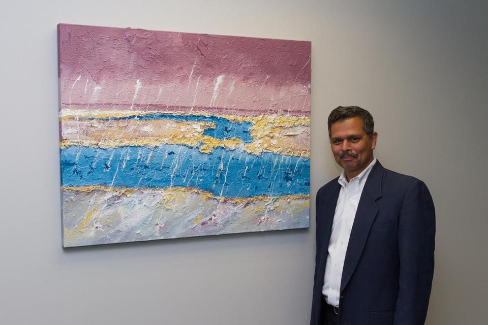 Dr. Sidhartha Pani, with one of his paintings that hangs in his medical office.