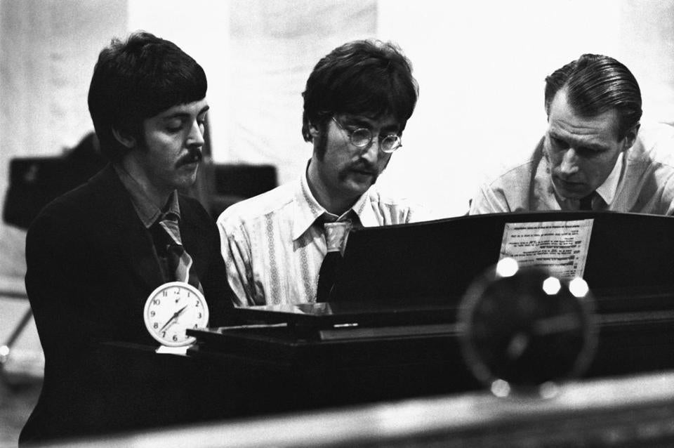 George Martin, far right, with Paul McCartney and John Lennon.
