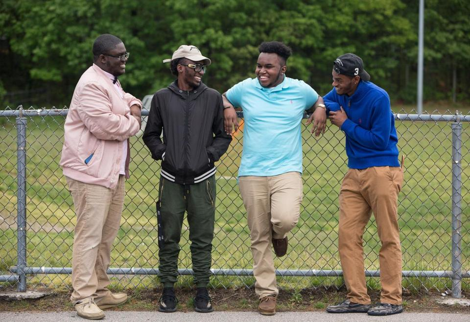 From left: Robert Simon, Christopher Michele, Paul Joseph, and De'Vante Mathurin outside the Ohrenberger Community Center in West Roxbury.