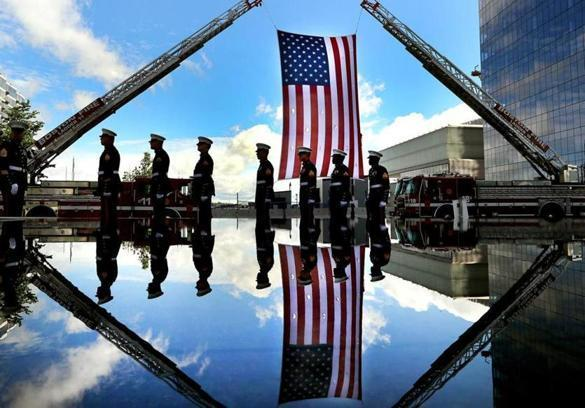 Marines were reflected in the water of the Massachusetts Fallen Heroes Memorial on Saturday.