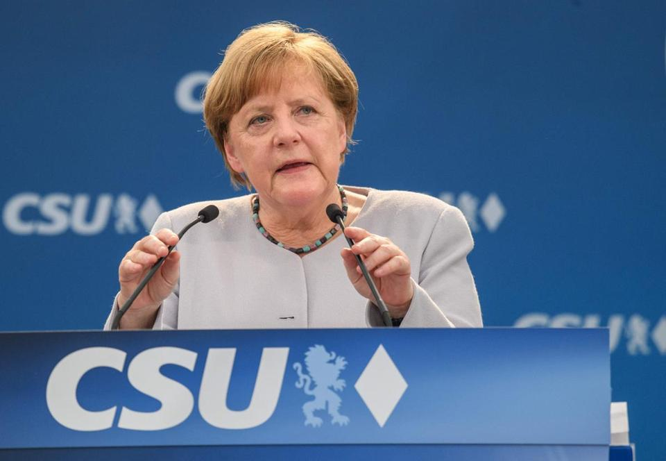 "German Chancellor Angela Merkel delivers a speech during a joint campaigning event of the Christian Democratic Union (CDU) and the Christion Social Union (CSU) in Munich, southern Germany, on May 27, 2017. Europe ""must take its fate into its own hands"" faced with a western alliance divided by Brexit and Donald Trump's presidency, German Chancellor Angela Merkel said Sunday. / AFP PHOTO / dpa / Matthias Balk / Germany OUTMATTHIAS BALK/AFP/Getty Images"