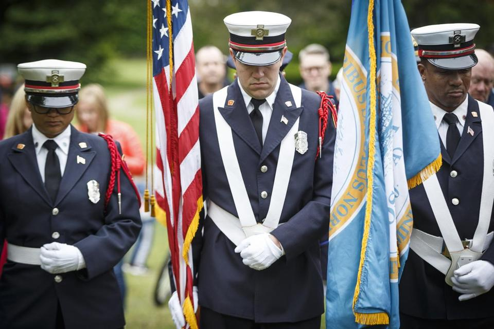 Boston, MA - 5/29/2017 - Members of the Boston Fire Department's honor guard bow their heads during a Memorial Day service at Cedar Grove Cemetery in Boston, MA, May 29, 2017.(Keith Bedford/Globe Staff)