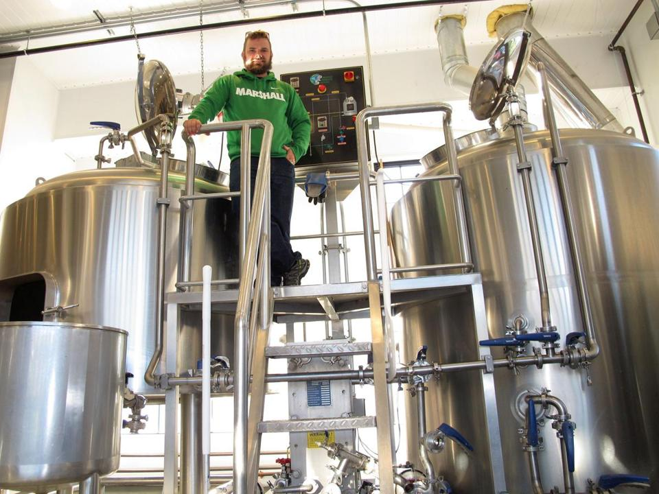 Hog Island Beer Co.'s brewer John Kanaga (top) in the Orleans brewery.