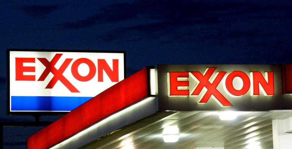 ExxonMobil's shareholders voted Wednesday to push the oil giant to test how the fight against global warming could affect its business.