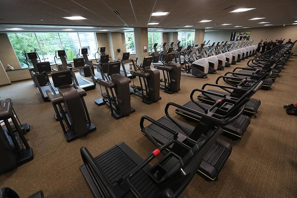 Chestnut Hill, MA., 05/31/17, A long row of treadmills in Life Time Center. After years as operating as the Atrium mall, the retail hub on Route 9 in Newton will reopen this week as the Life Time center, a mix of doctors offices and fitness facilities. The redevelopment is an experiment in repurposing old mall complexes that have fallen out of favor with shoppers. The hope is that the complex will serve as a lifestyle hub for high-end consumers. Suzanne Kreiter/Globe Staff