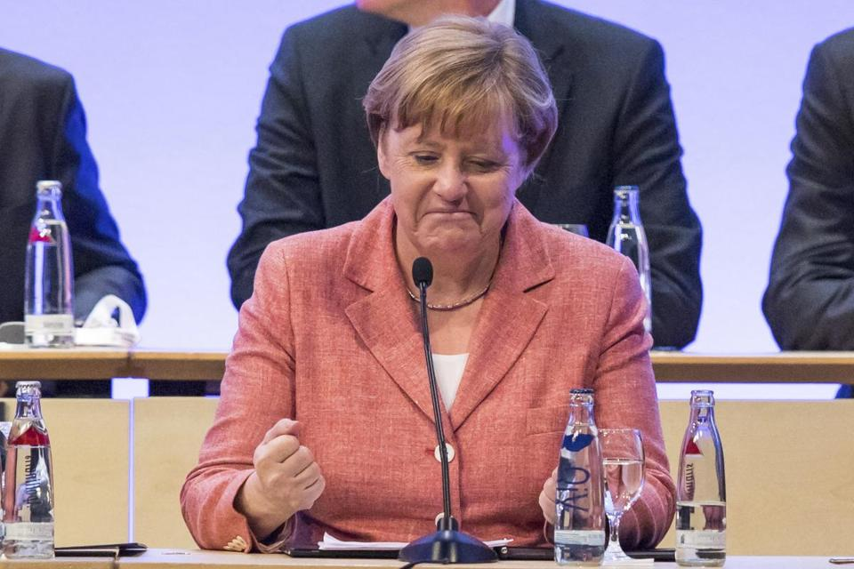 German Chancellor Angela Merkel attends a meeting of ' Deutscher Staedtetag' (Council of German cities and towns) in Nuremberg, Germany, Wednesday, May 31, 2017. (Daniel Karmann/dpa via AP)