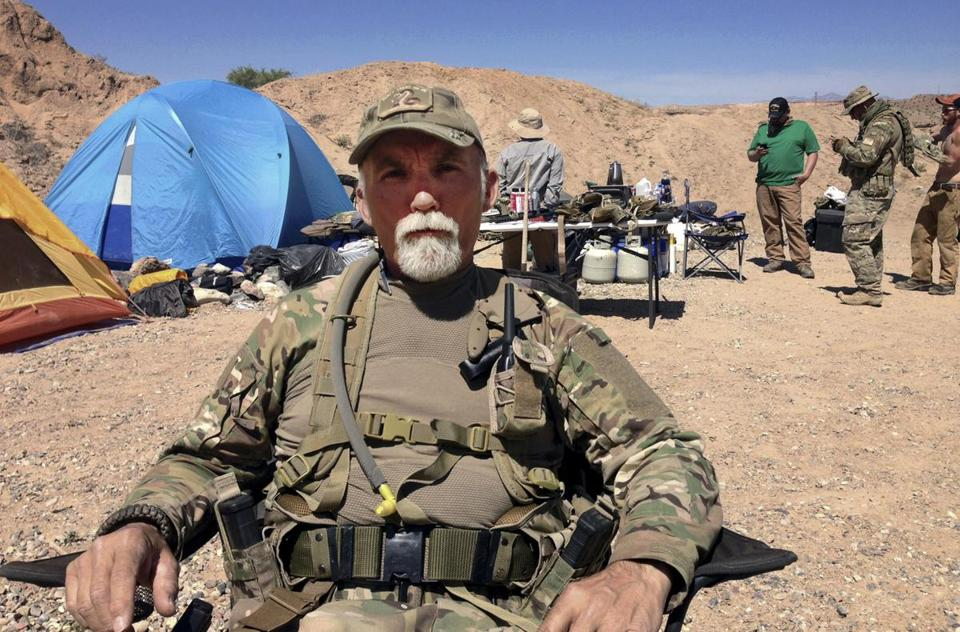 "Gerald ""Jerry"" DeLemus, of Rochester, N.H., sat with a group of self-described militia members at Cliven Bundy's ranch near Bunkerville, Nev., on April 16, 2014."