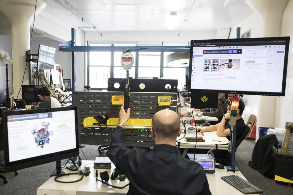 A Tulip Interfaces employee demonstrated the company's system. It uses cameras, sensors, and Internet-connected tools to help factory workers follow the proper steps when assembling a complex product.