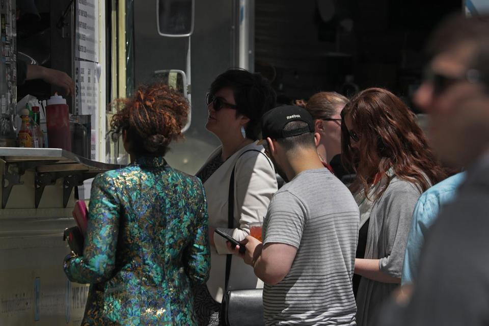 Customers lined up during lunch hour at a food truck in Dewey Square last week.