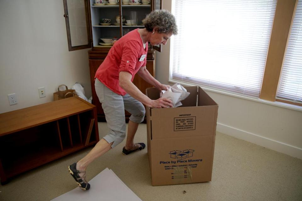 06/01/2017 Dedham Ma- Toby Sandler (cq) age 66 is still in the workforce.She works at Move Maven,and helps clients with their moving needs. Globe Staff\Photograph Jonathan Wiggs Reporter:Topic