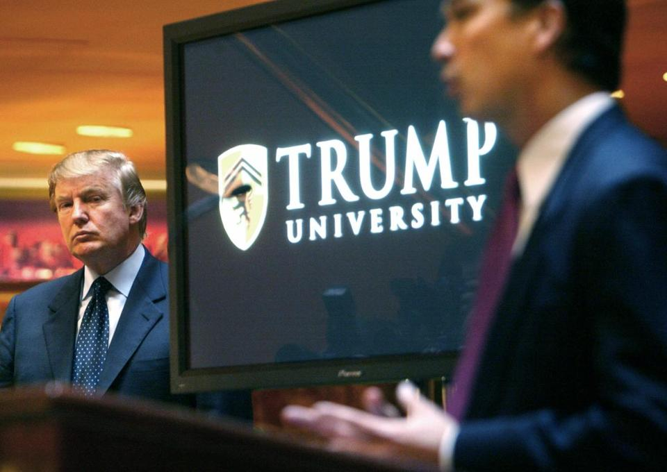 FILE- In this May 23, 2005 file photo, real estate mogul and Reality TV star Donald Trump, left, listens as Michael Sexton introduces him at a news conference in New York where he announced the establishment of Trump University. The presidential campaigns of Hillary Clinton and Trump are both trying to prevent the public release of videos that are critical to legal cases involving the candidates. (AP Photo/Bebeto Matthews, File)