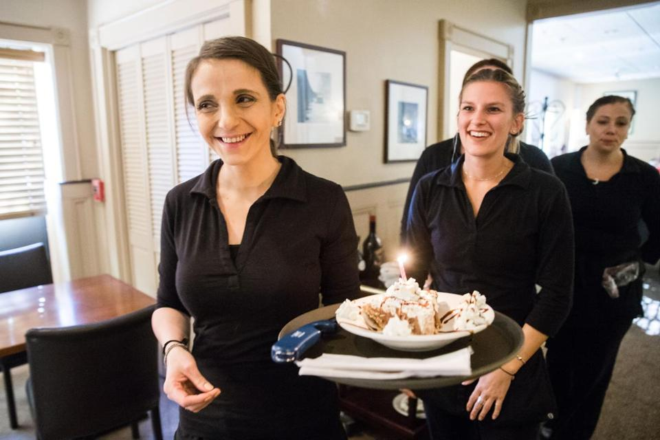 Servers Kate Titberidze (left) and Samantha Klesaris broiught out dessert at Good Thymes in Lowell.