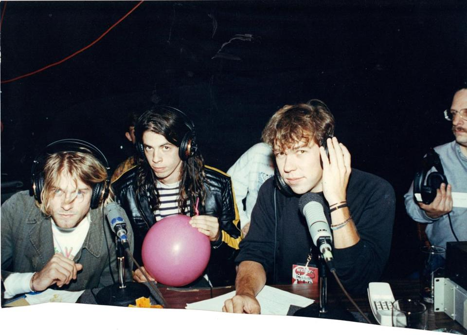 WFNX's Kurt St. Thomas (right) interviewing Nirvana's Kurt Cobain (left) and Dave Grohl on Lansdowne Street in 1991.