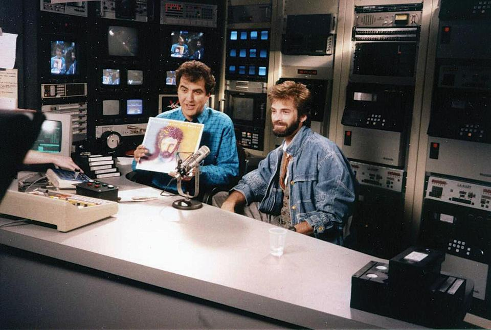 for Globe West 02/19 - the famous V66 channel that predated MTV and was based out of Framingham and Marlborough. V66 founder John Garabedian on-air with Kenny Loggins, 1985. (handout)