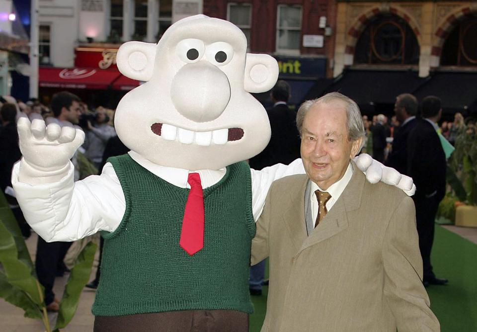 "FILE - In this Sunday, Oct. 2, 2005 file photo, British actor Peter Sallis, who voices the part of Wallace poses with a person dressed as the character 'Wallace' on arrival at the Leicester Square Odeon, London for the premiere of Wallace & Grommit: The Curse of the Were-Rabbit. Sallis, who played irrepressible, cheese-loving inventor Wallace in the ""Wallace and Gromit"" cartoons, has died. He was 96. Sallis' agents, Jonathan Altaras Associates, say he died Friday, June 2, 2017 in London. (AP Photo/Paul Ashby, File)"