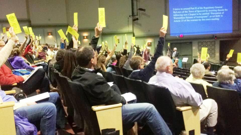Town Meeting votes to pass a bylaw making Ipswich a sanctuary town. ( Lindsay Randall photo)