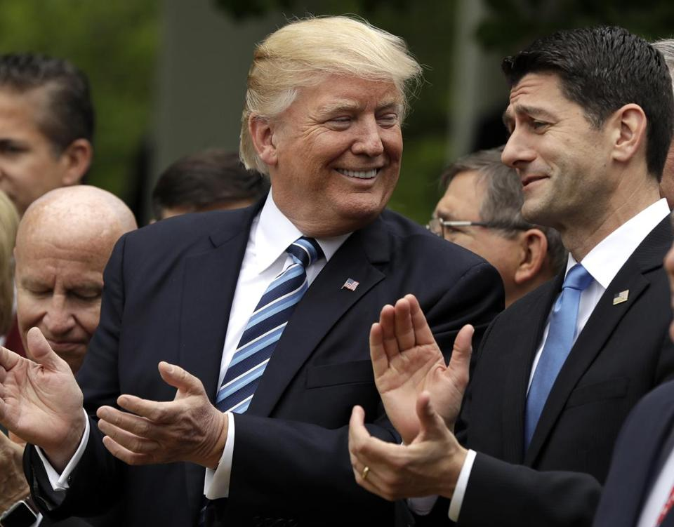 President Donald Trump spoke with House Speaker Paul Ryan during a ceremony in the Rose Garden of the White House after the House pushed through a health care bill in May.
