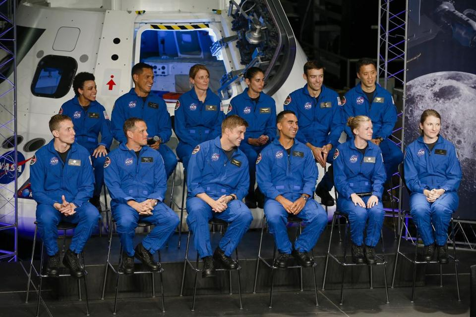 Twelve new astronaut candidates are introduced at the Johnson Space Center in Houston on Wednesday, June 7, 2017. NASA chose 12 new astronauts Wednesday from its biggest pool of applicants ever, selecting seven men and five women who could one day fly aboard the nation's next generation of spacecraft. (Michael Ciaglo/Houston Chronicle via AP)