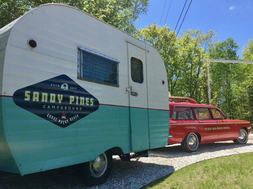 """Sandy"" the vintage Corvair pulls a camper at the Sandy Pines Campground in Kennebunkport, Maine."