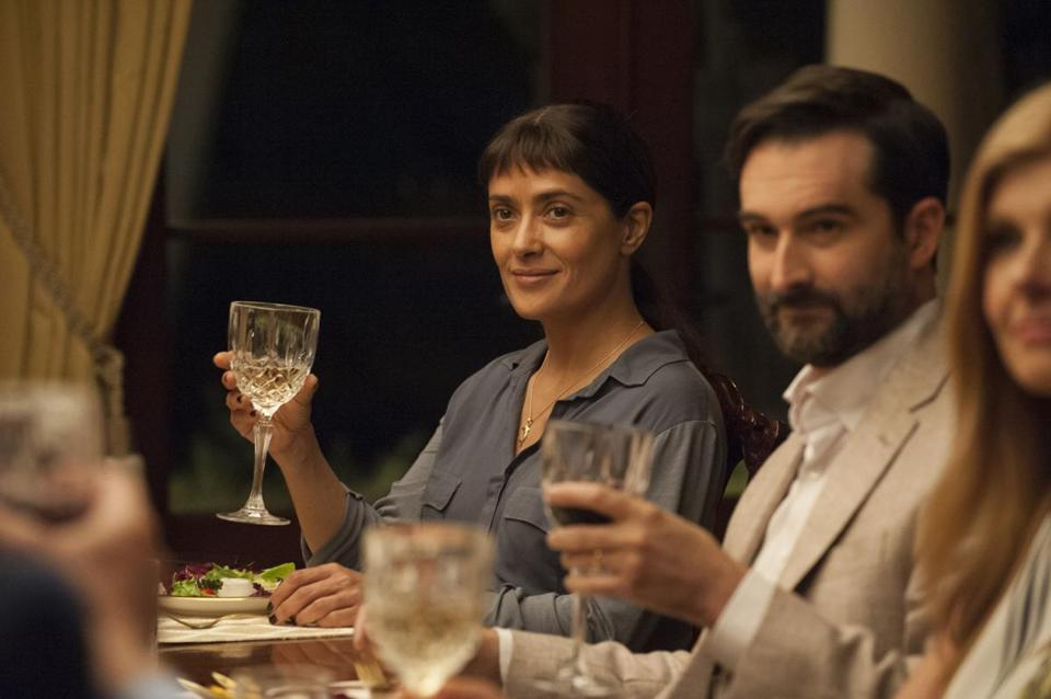 "John Lithgow (above) and Salma Hayek (top, with Jay Duplass) in ""Beatriz at Dinner."""