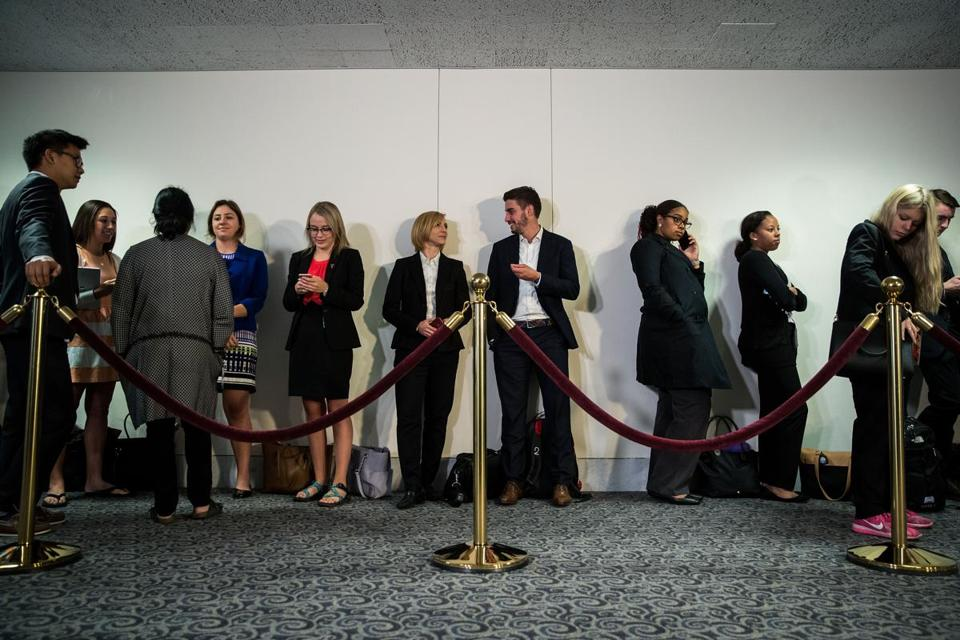 People waited in line outside the hearing room.