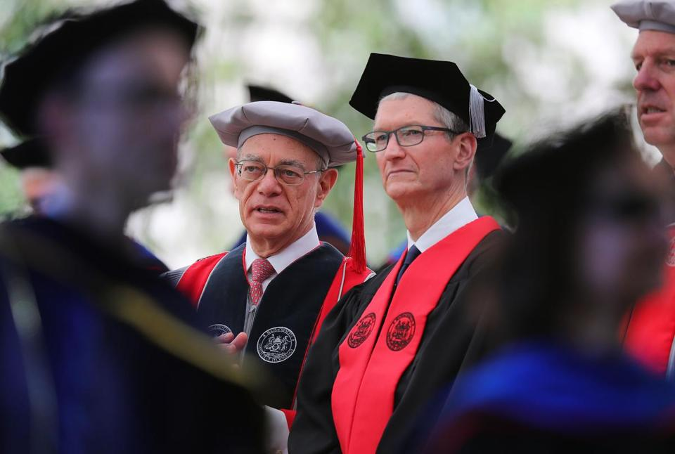 MIT president L. Rafael Reif (left) chatted with Tim Cook during the procession Friday.