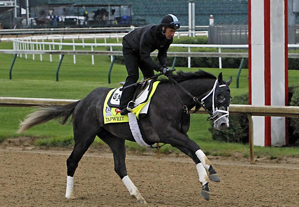 Kentucky Derby entrant Tapwrit, ridden by exercise rider Silvio Pioli, gallops during a morning workout at Churchill Downs in Louisville, Ky., Thursday, May 4, 2017. The Kentucky Derby horse race is set for Saturday, May 6. (AP Photo/Garry Jones)