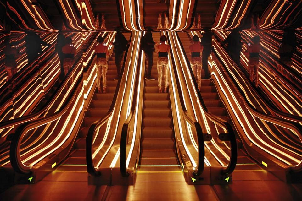 An optical illusion of a single escalator, center, in the lobby of the PUBLIC hotel, is created by its reflective surroundings, in New York, Tuesday, June 6, 2017. The new hotel opening Wednesday, June 7, 2017, on Manhattan's Lower East Side is the latest project from Ian Schrager, who's known for introducing the concept of boutique hotels and as co-founder of the legendary disco Studio 54.(AP Photo/Richard Drew)