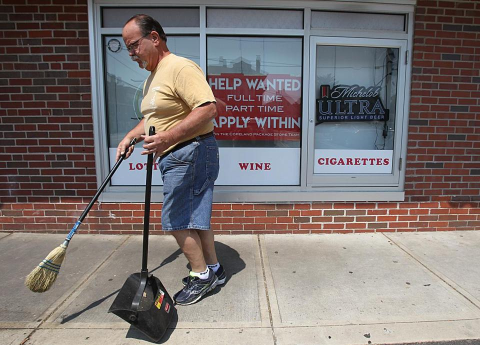 Quincy, Ma., 06/13/17, Copeland Package Store owner Dennis Carson sweeps up the side walk in front of his store. Employers struggle to find workers as the unemployment rate hits a 16-year low and the number of job openings rises to the highest level since 2000. Suzanne Kreiter/Globe Staff