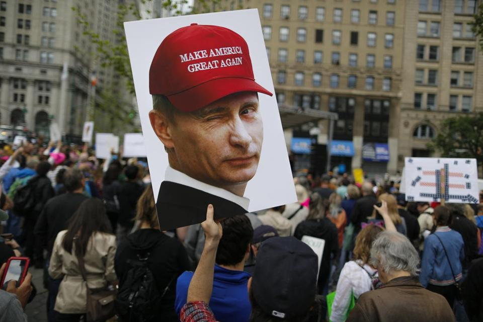 NEW YORK, NY - JUNE 03: A demonstrator holds up a sign of Vladimir Putin during an anti-Trump 'March for Truth' rally on June 3, 2017 in New York City. Rallies and marches are taking place across the country to call for urgent investigation into possible Russian interference in the U.S. election and ties to U.S. President Donald Trump and his administration. (Photo by Eduardo Munoz Alvarez/Getty Images)