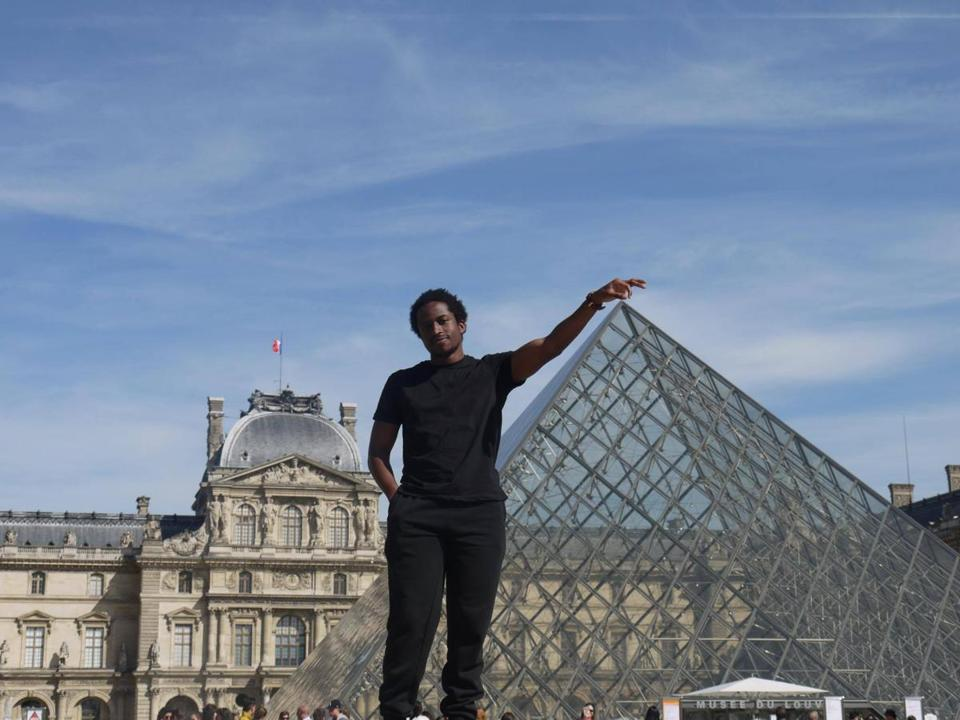 "15studyabroad - R??ichard Nzekwu, a student at Northeastern University, visiting ""Le Louvre"" museum in Paris, France on May 10. (handout)"