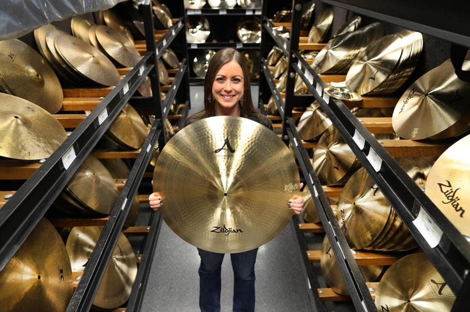 Sarah Hagan with Zildjian cymbals at the company's Norwell headquarters.